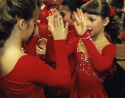 Christina (8) (on right) and other skaters ready for their Pops on Ice performance, 1998.
