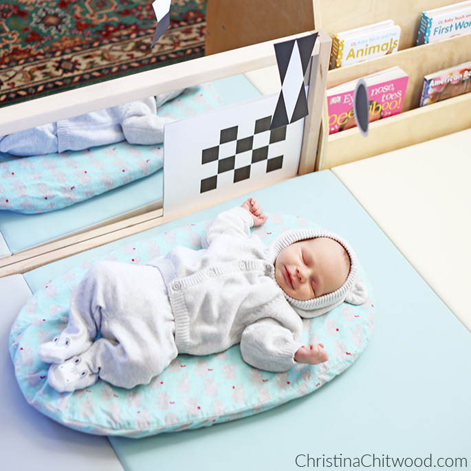 Smiling as He Sleeps in His Montessori Newborn Baby Space