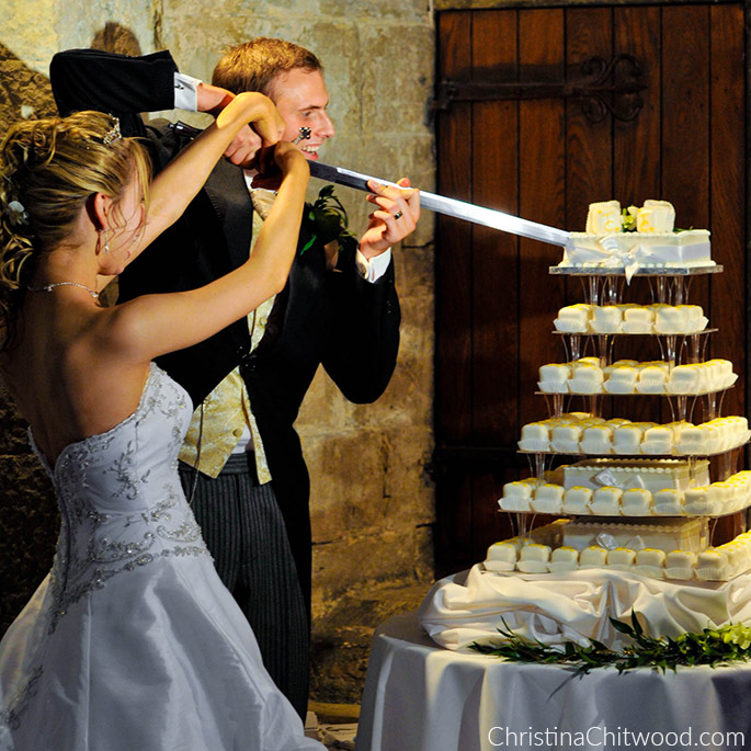 Christina and Tom Cutting the Cake with a Sword