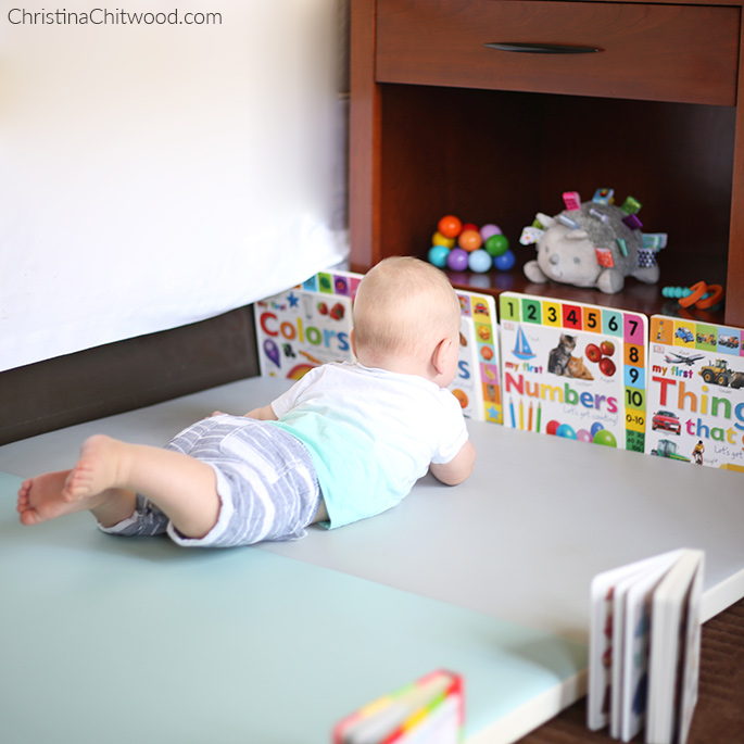 Our Baby Boy Gettiing a Close Look at the Books in His Montessori Space on His Fourth Trip at 5 Months Old
