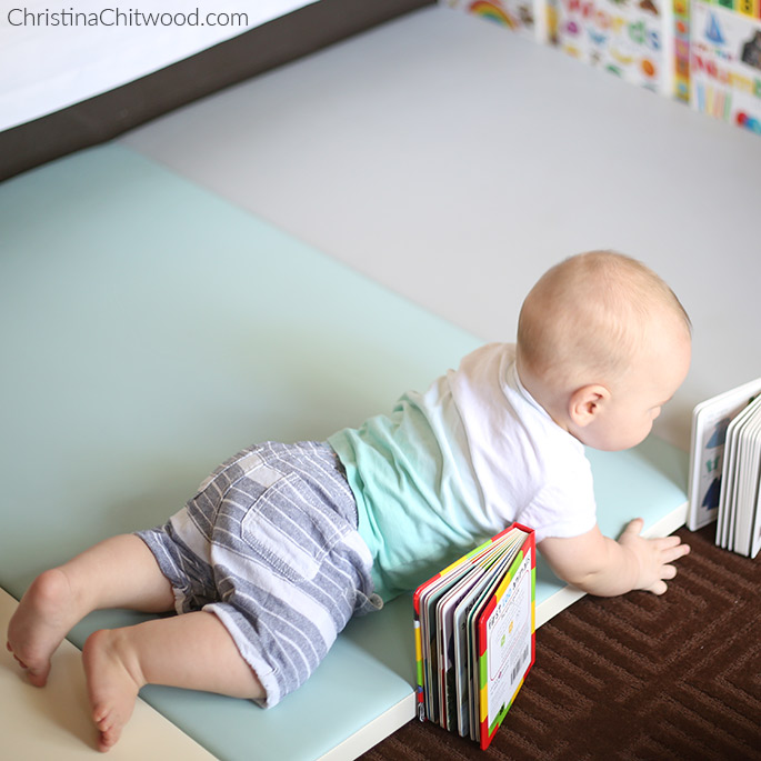 Our Baby Boy Getting a Closer to a Book in His Montessori Space on His Fourth Trip at 5 Months Old