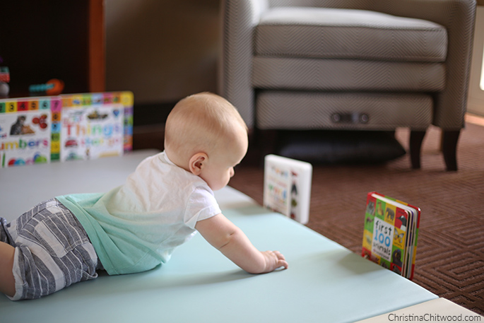 Our Baby Boy Studying a Book in His Montessori Space on His Fourth Trip at 5 Months Old