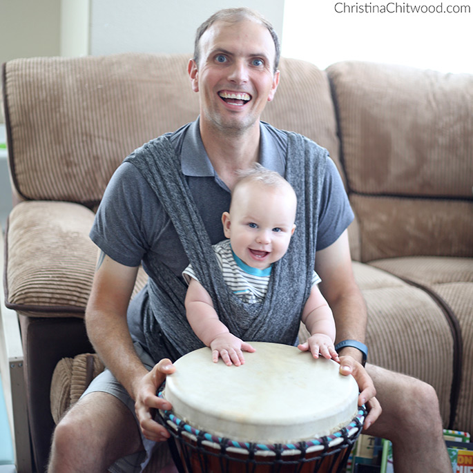 Daddy Babywearing His Baby Boy at 7 Months Old While Playing the Djembe Drum