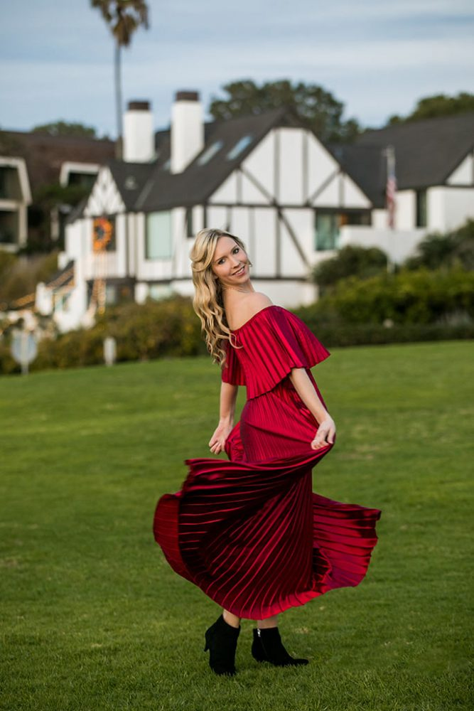 Fashion blogger, Christina Chitwood, twirling in metallic red maxi dress. Womens Fashion Amazon Maxi Dress, Circus by Sam Edleman Booties, Nadri Earrings