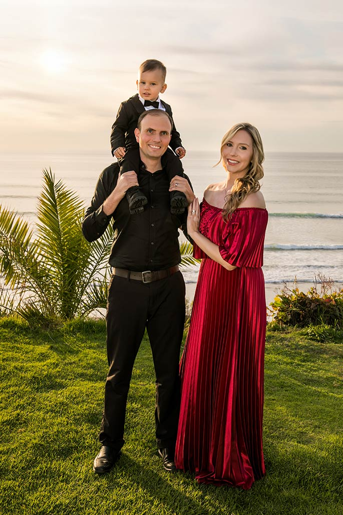 Fashion blogger, Christina Chitwood, with her husband, and toddler son on his shoulders. Womens Fashion Amazon Maxi Dress, Circus by Sam Edleman Booties, Nadri Earrings. Boys Hope and Henry Tuxedo